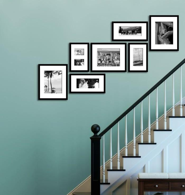 Family Photos Display Along The Staircase On The Blue Wall
