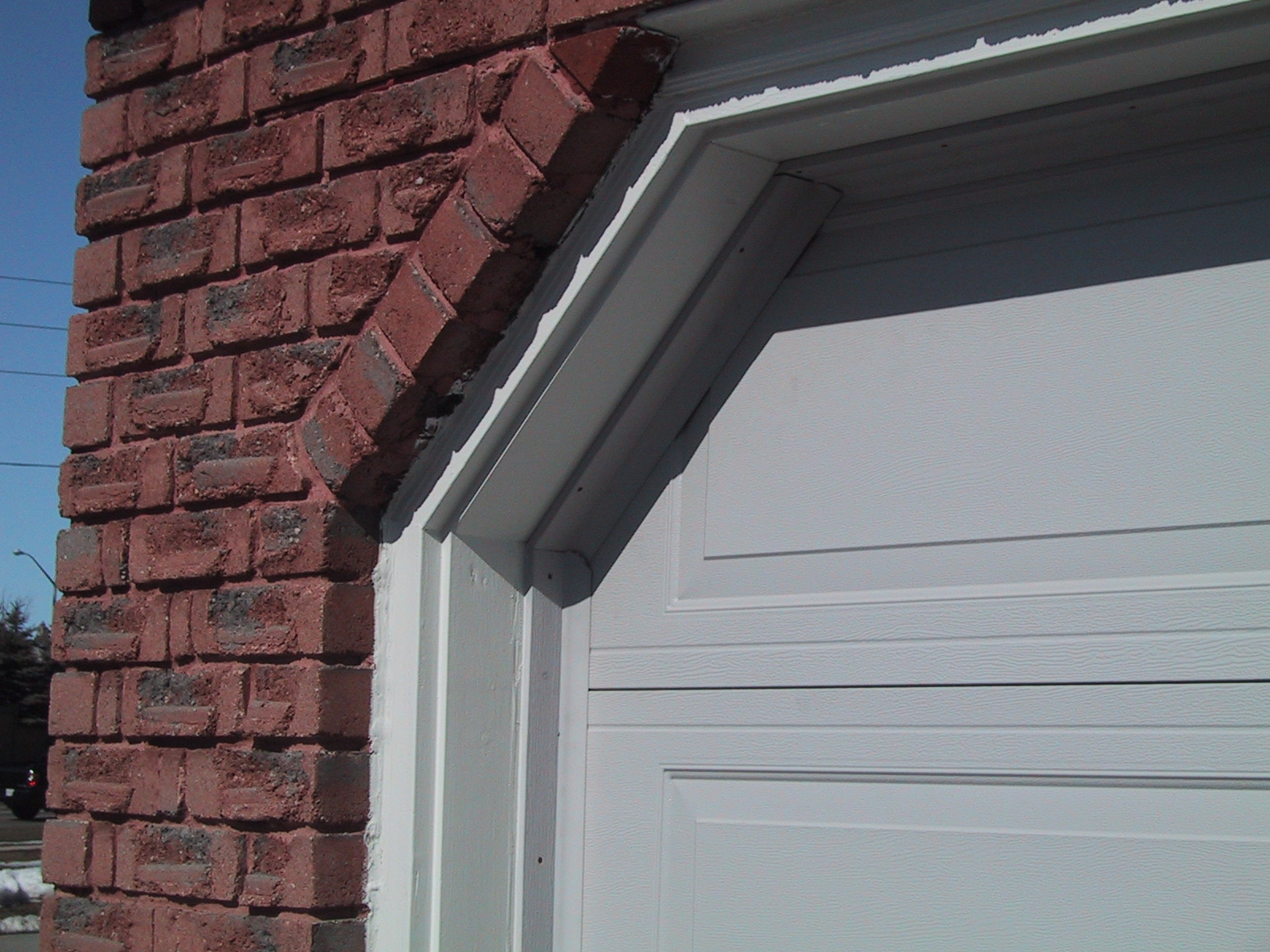 Making the right application of garage door weather for Garage side door and frame