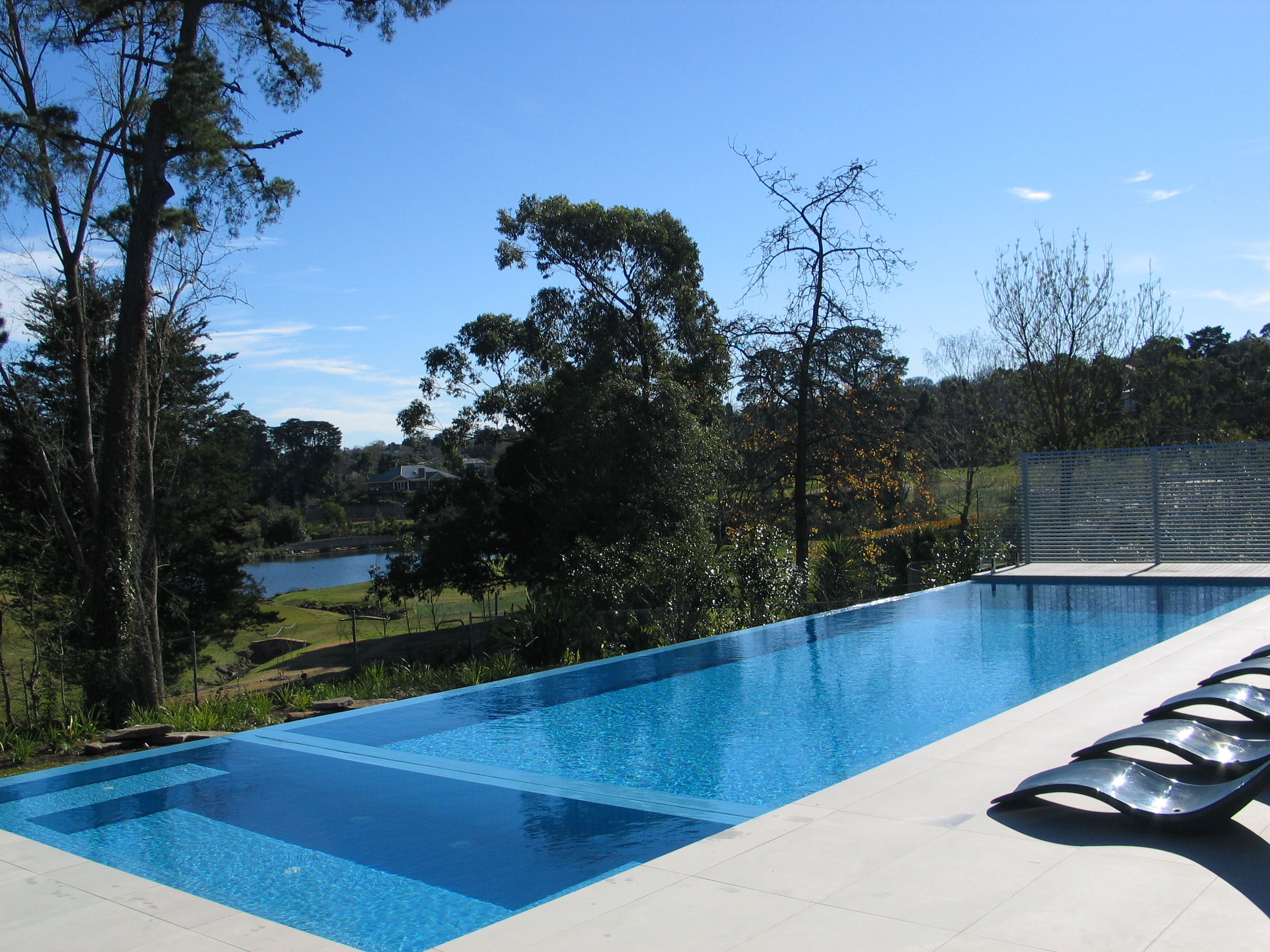 Infinity pool designs pool cost pictures of inground for Pool edges design
