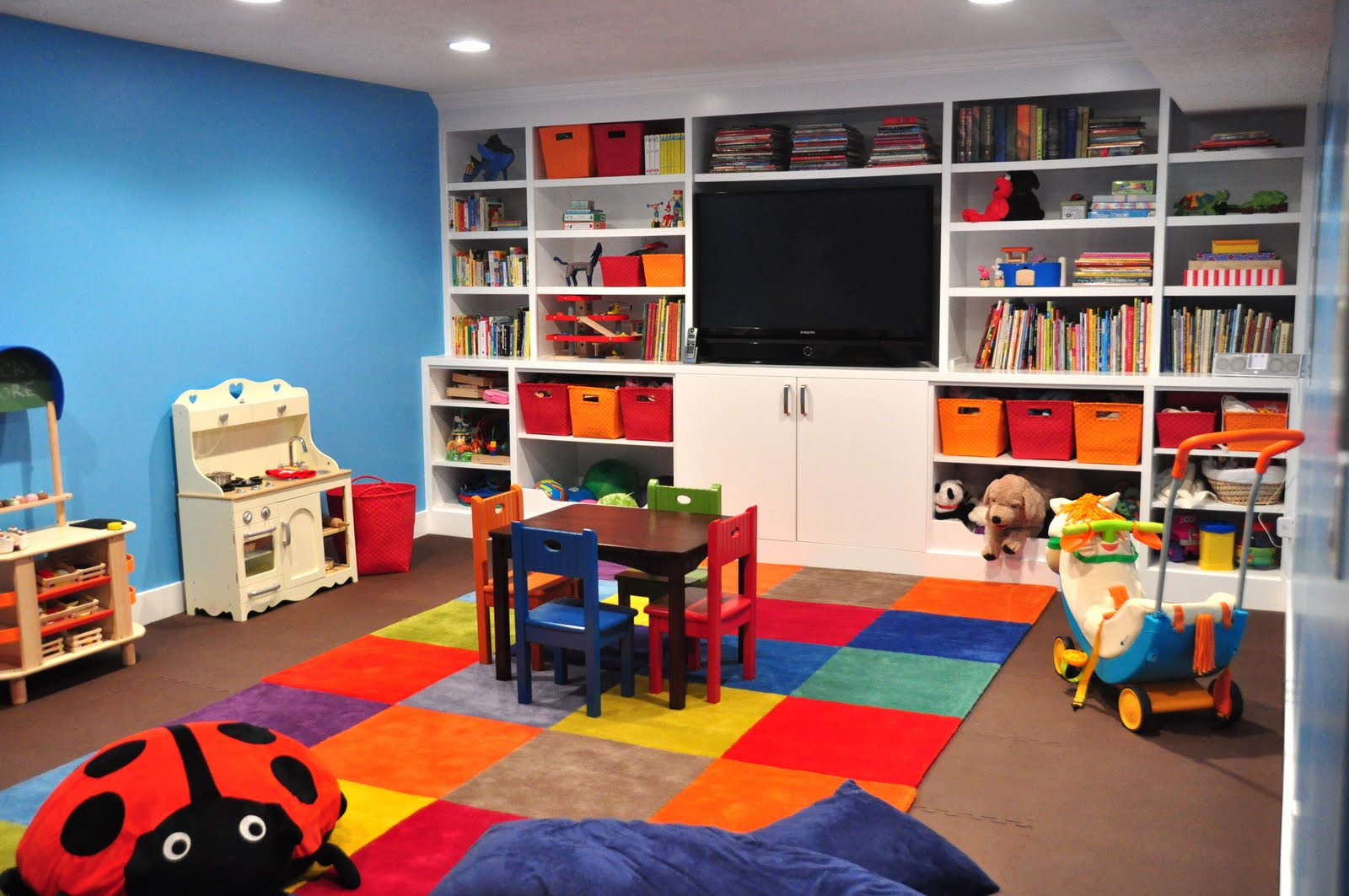 Patchwork Rug Of Bright Multicolored Squares Built In Storage And Flatscreen TV (View 9 of 10)