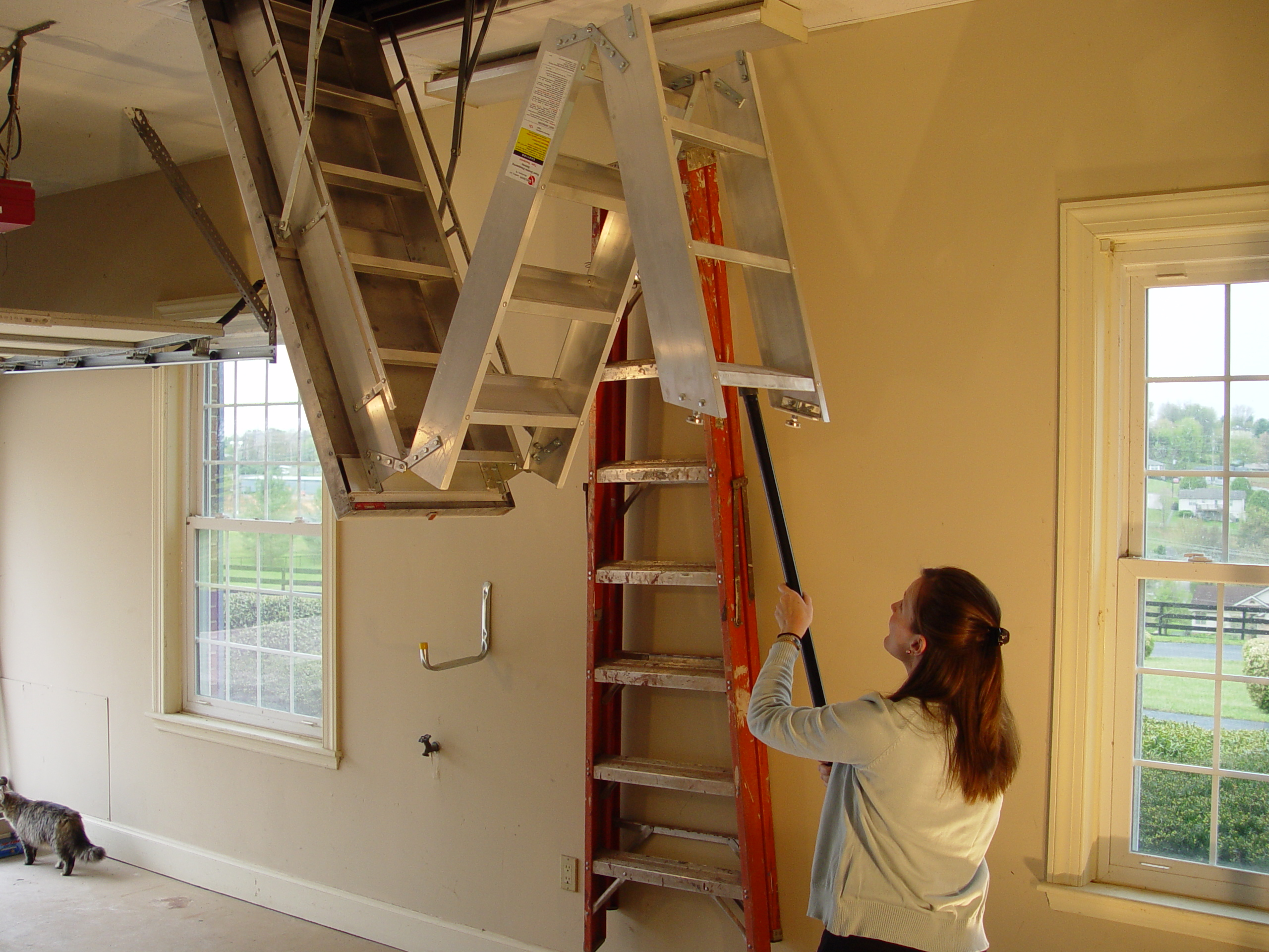 Steel Installation Of Pull Down Stairs (Photo 9 of 10)