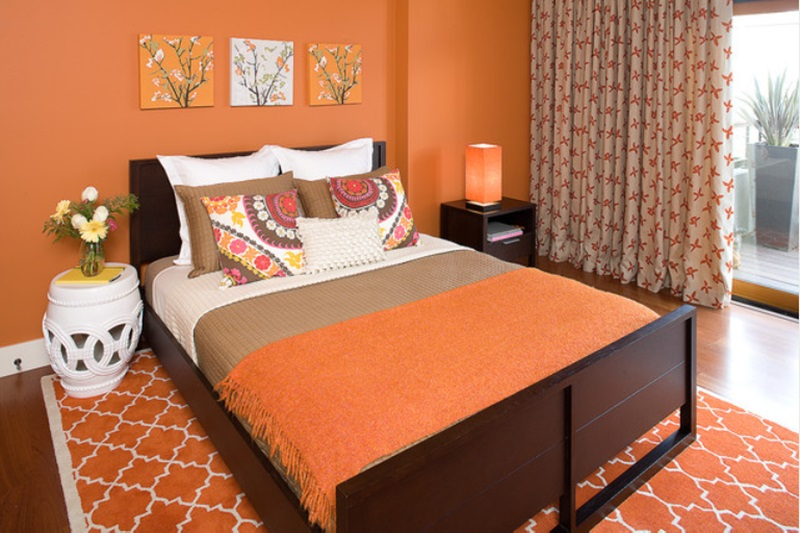 bedroom with orange wall paint