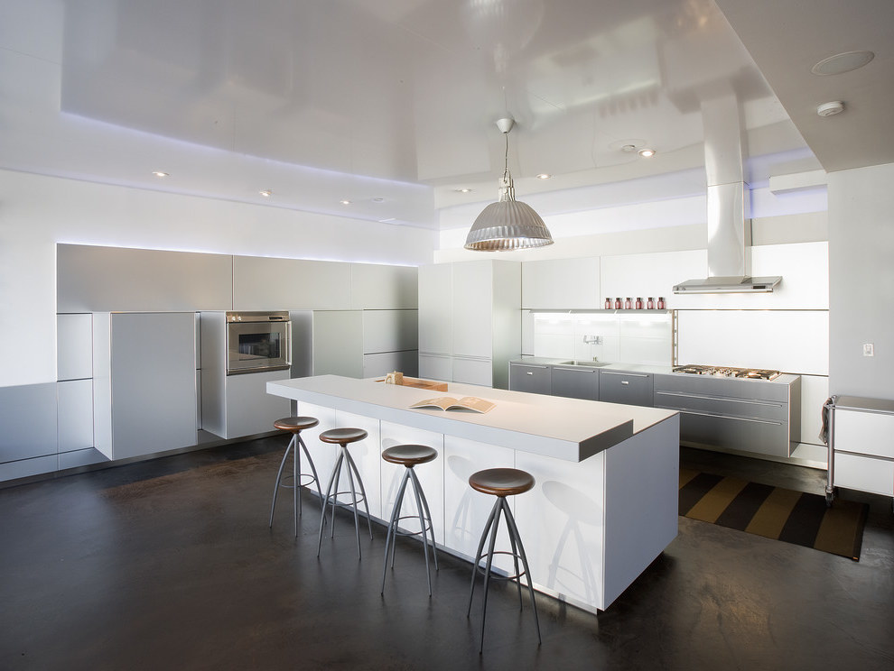 Contemporary Futuristic Kitchen with Laminate Countertops and Paneled Appliances