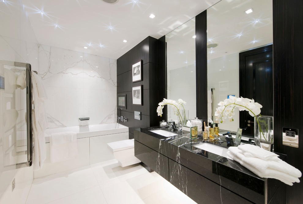 Modern Black and White Bathroom with Flat-Panel Cabinets