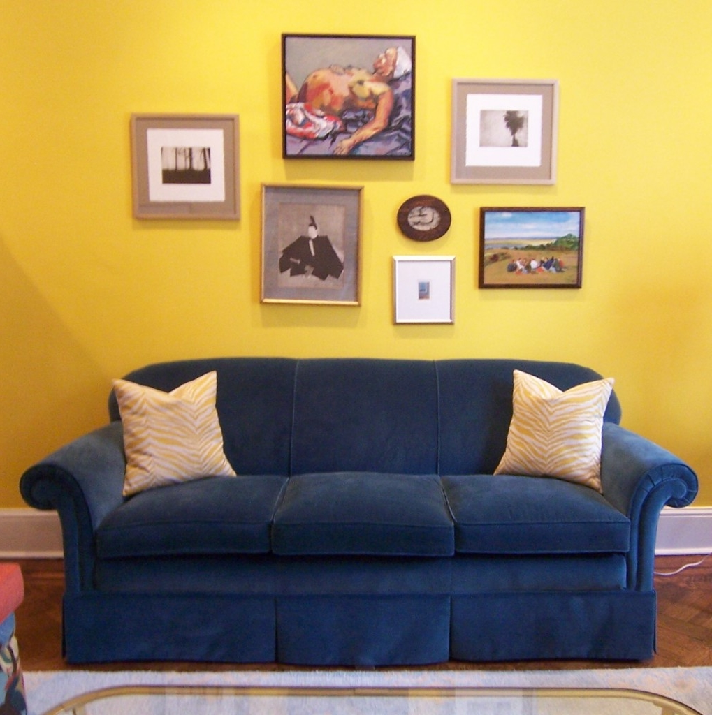 Bright Yellow Wall Paint Color Background With Art Paintings Decor ...