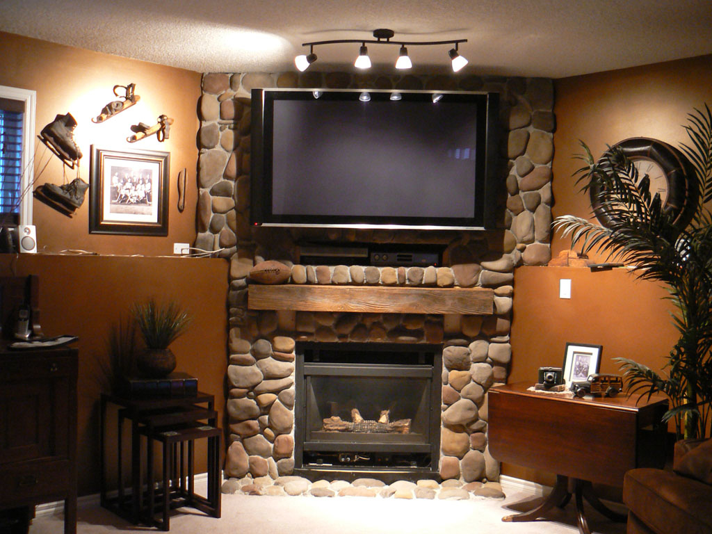 Cool Brown Wall Paint Color Background With Rustic Stoned Fireplace Mantel Plus Tv In Over