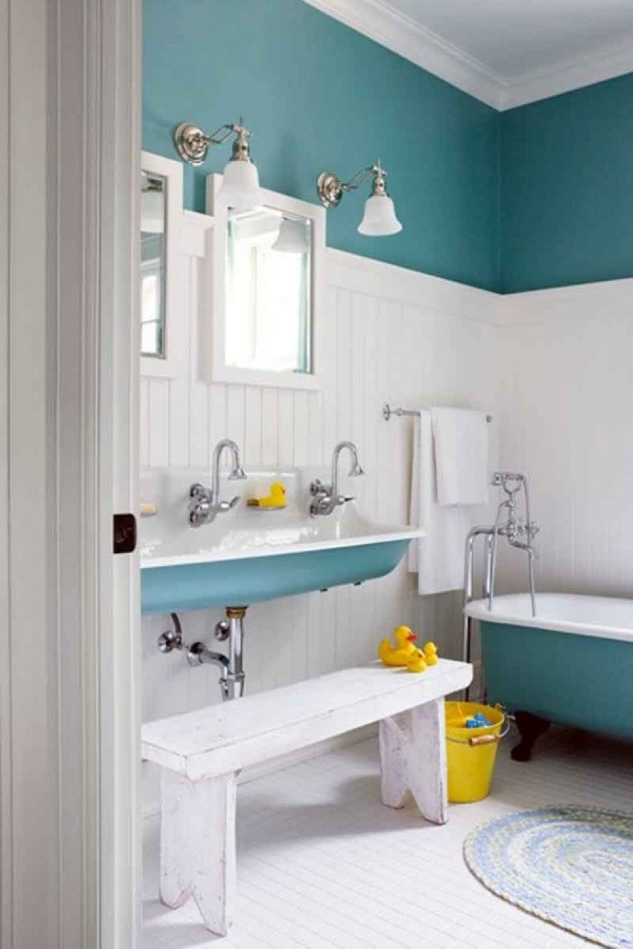 Turquoise and grey bathroom - Cool Oval Grey Rug With Turquoise Kids Bathroom Painting Idea Also White Bench Beside Yellow Bucket