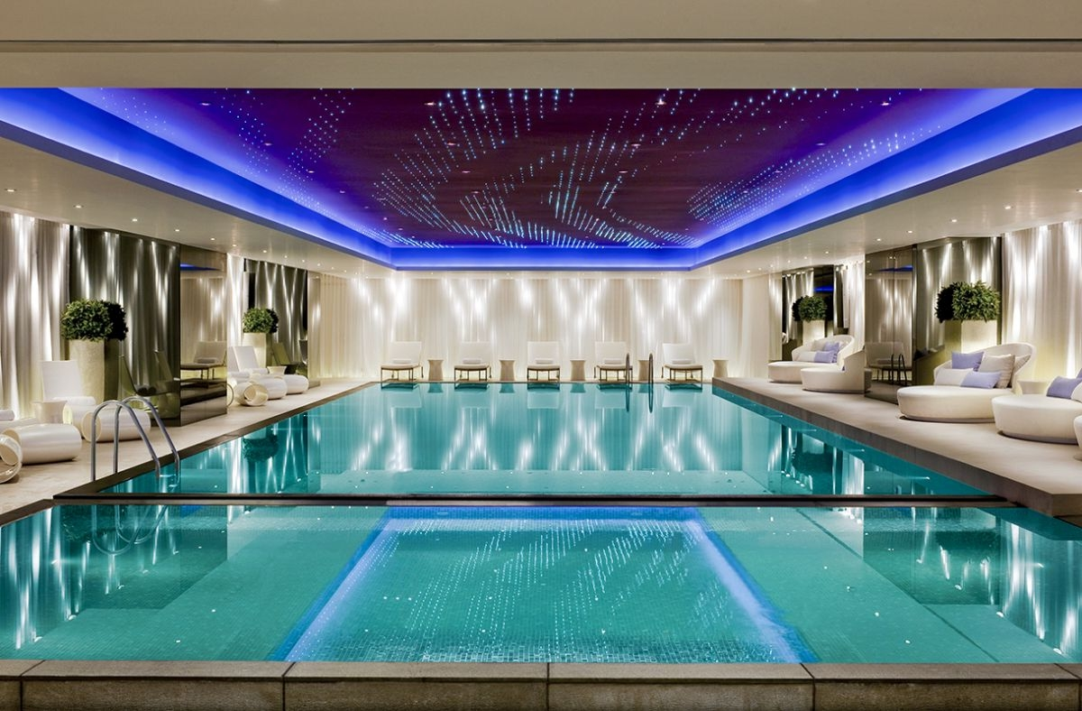 Fancy Blue Tracy Ceiling Recessed Lighting Over Indoor Pool Plus White Seating Area And