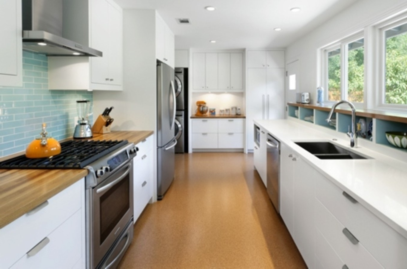 Long White Galley Kitchen With Stainless Steel Appliances Also Teal ...