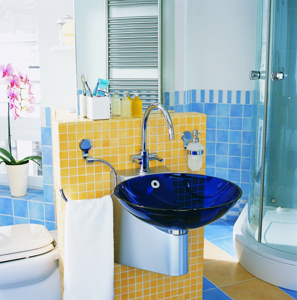 Modern Curved Glass Shower Room With Stainless Steel Towel Rail Plus Blue And Yellow Kids Bathroom