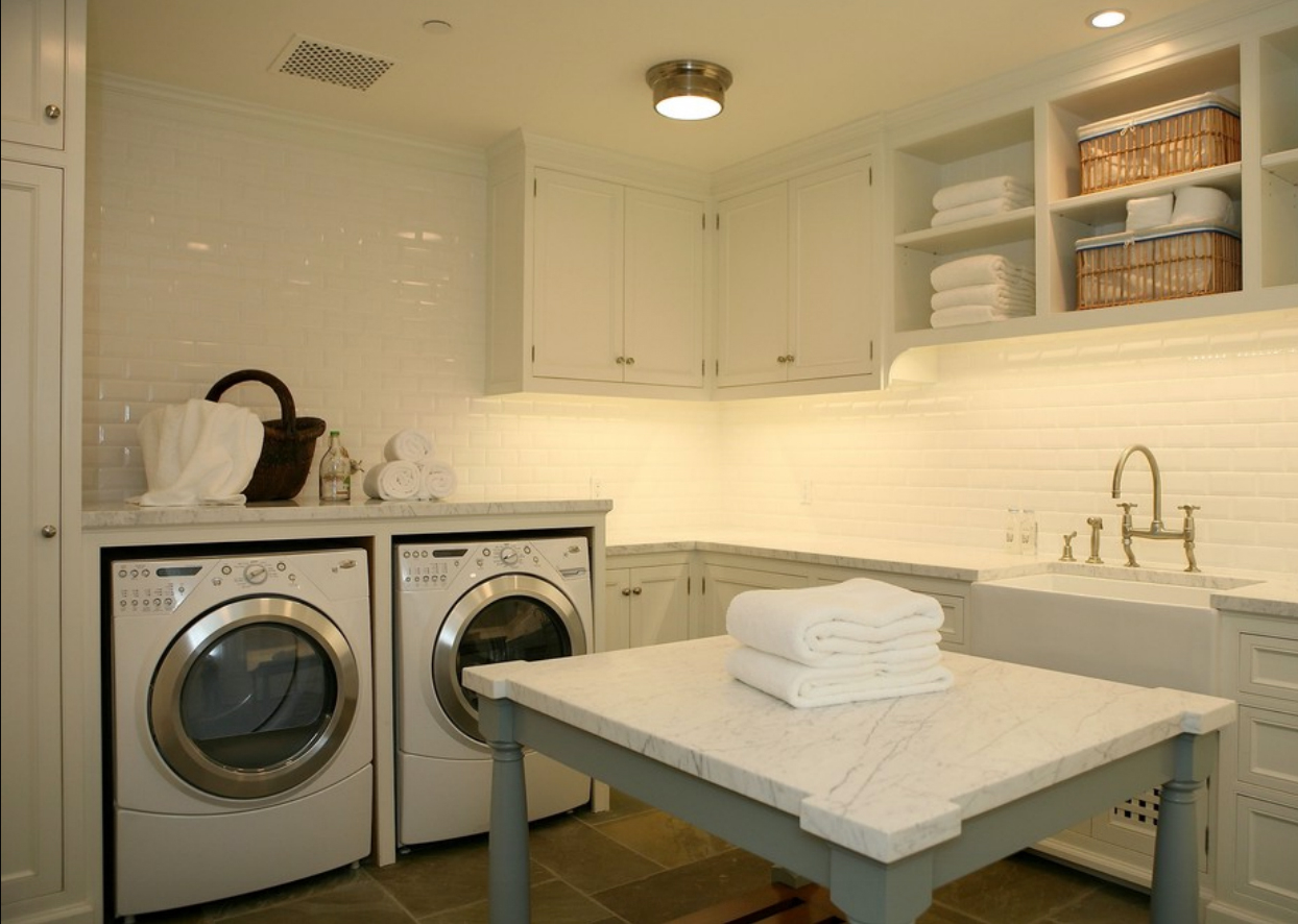 Monochromatic White Laundry Room Design With Recessed Lighting Also Gold Faucet And Farmhouse Sink Photo
