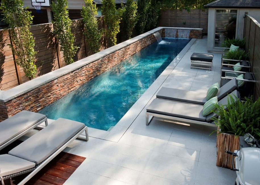 Narrow Rectangular Pool Design With Brown Lounge Chairs Plus White ...