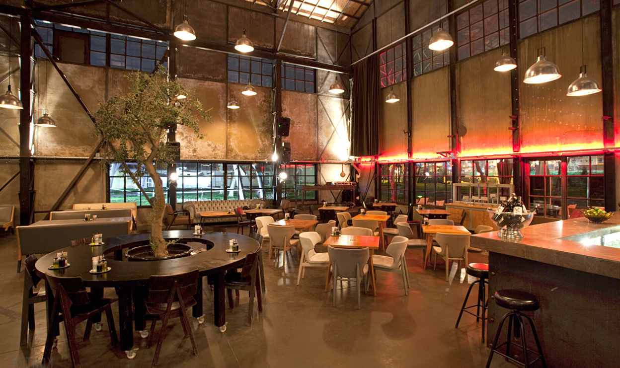 rustic cafe interior decorating design with huge potted tree plus industrial pendant lighting photo 2663