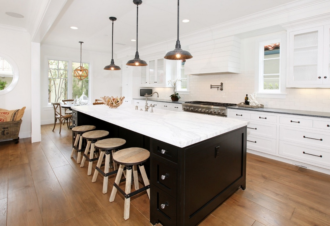 Rustic Round Wood Stools Slipped Under Black Kitchen Island With ...