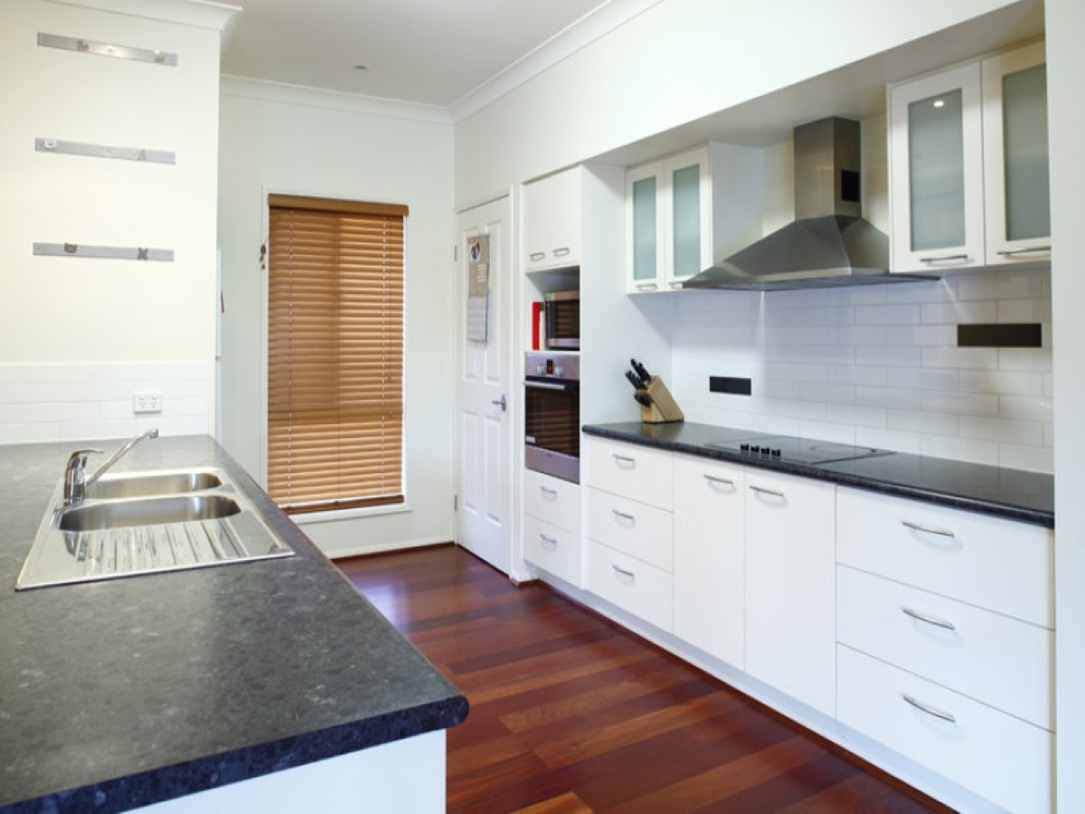 Sleek Laminate Floor Background Combined With Awesome White Galley ...