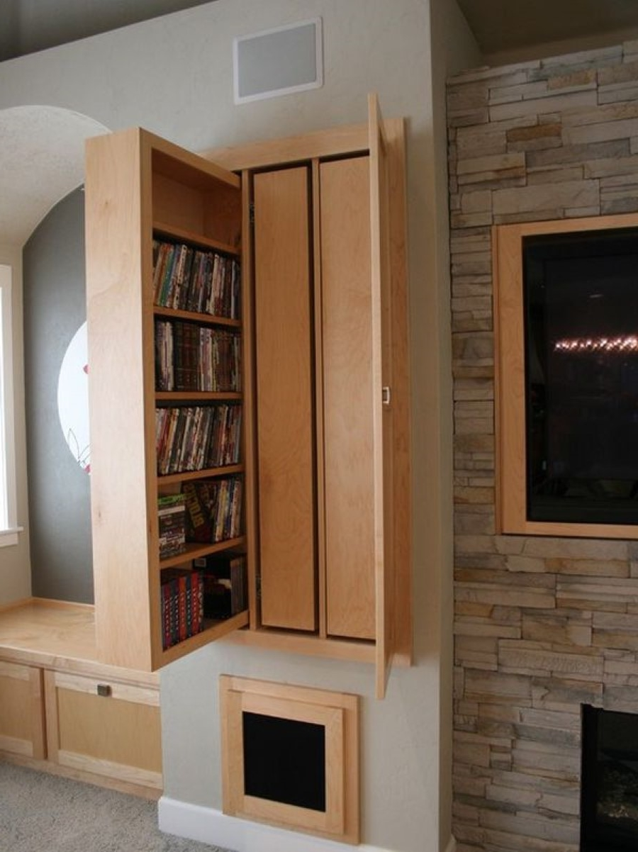 Smart Wooden Pull Out Hidden Storage Idea With Brown Wall Paint Color Background Plus Stoned Fireplace & Smart Wooden Pull Out Hidden Storage Idea With Brown Wall Paint ...