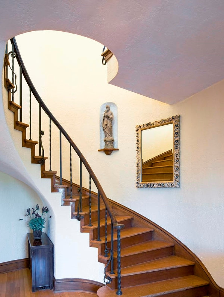Traditional Wooden Console Table Put Under Curved Staircase With Railing Set Plus Ceiling Hole Design