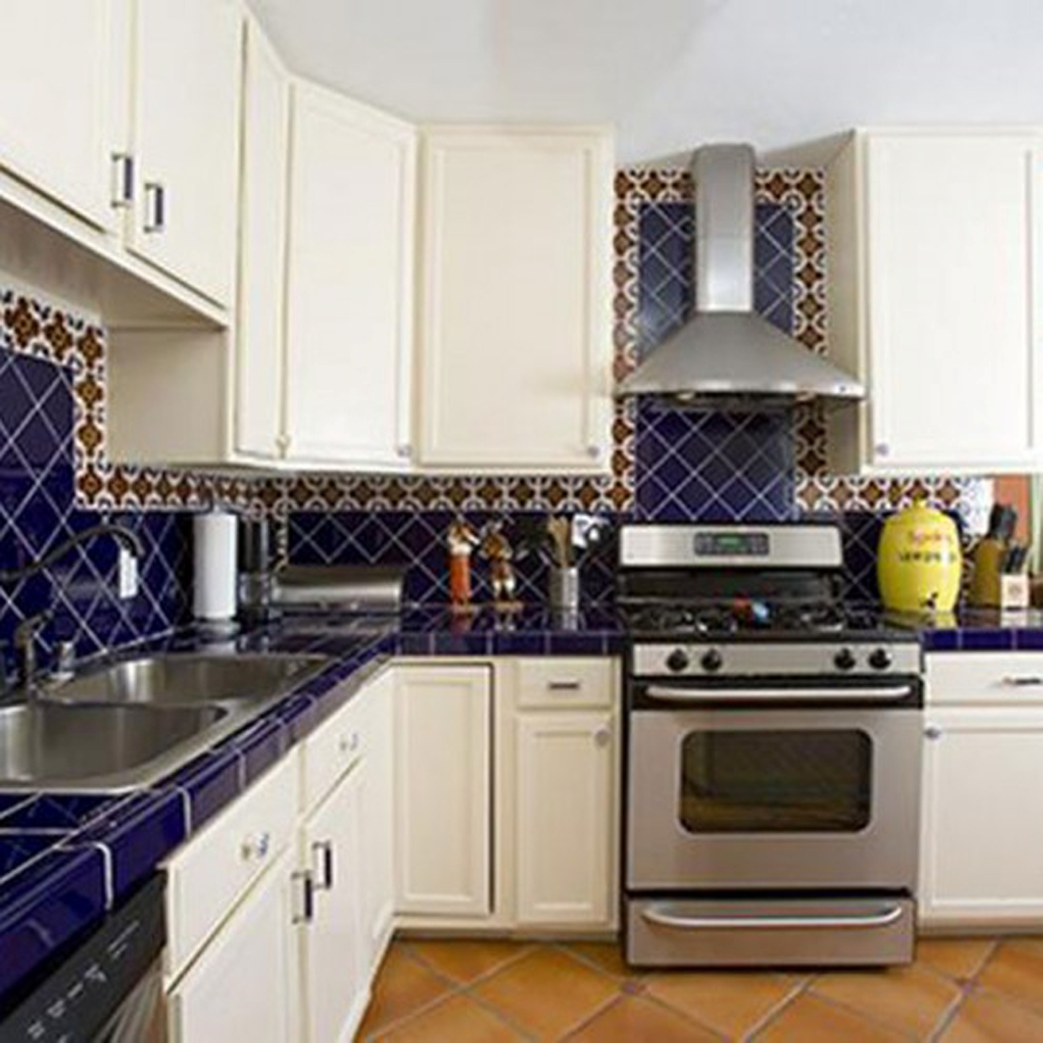 Modern Kitchen Tiles Backsplash With Delightful Metal Sink Ideas Plus  Pleasant White Wooden Kitchen Cabinets Storage