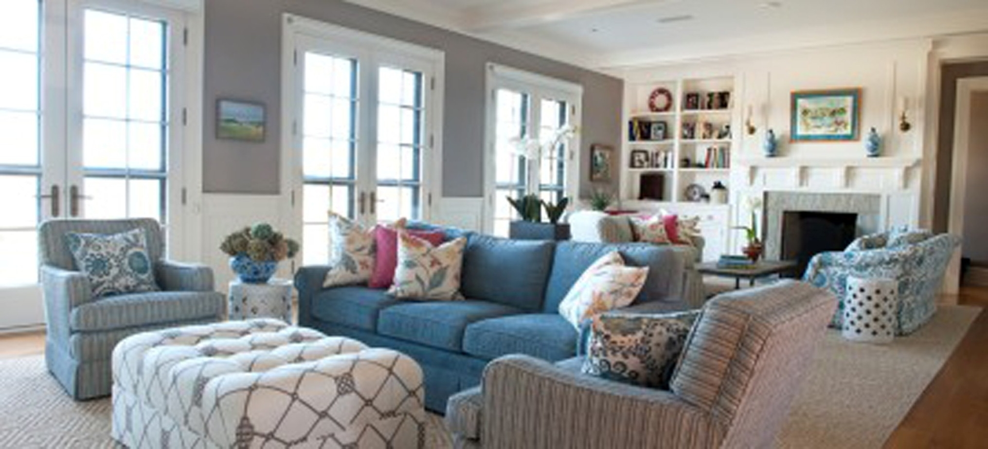 Modern Living Room Interior Design With Gorgeous Blue Sofa Plus Outstanding White Ottoman Design (Image 20 of 30)