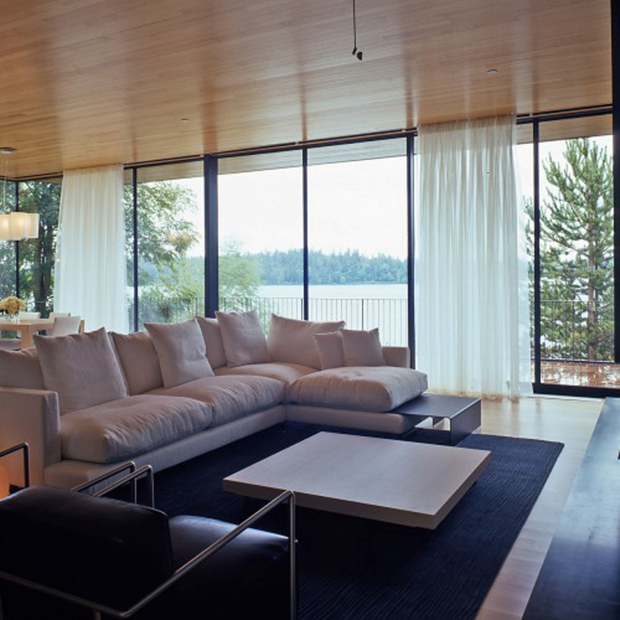 Modern Living Room With Spacious Modern White Sofa Also Licious Window Glass Design (Image 27 of 30)