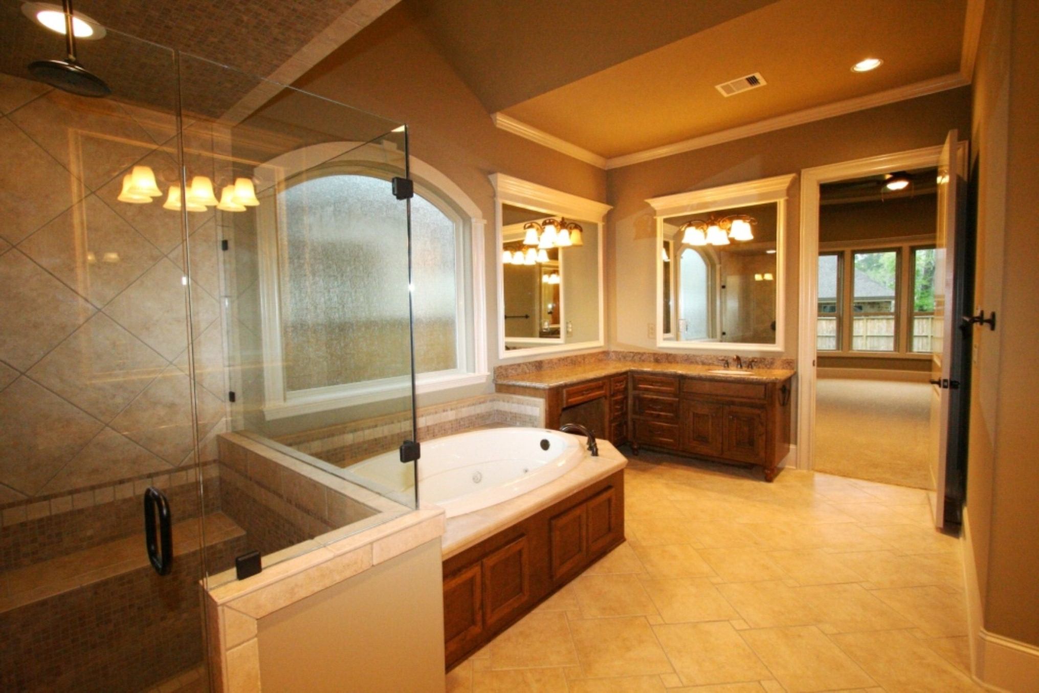 Neat Inspirational Oval Bathtub And Glass Shower Door Design Feat Corner Vanity Idea In Compact Master Bathroom (View 9 of 21)