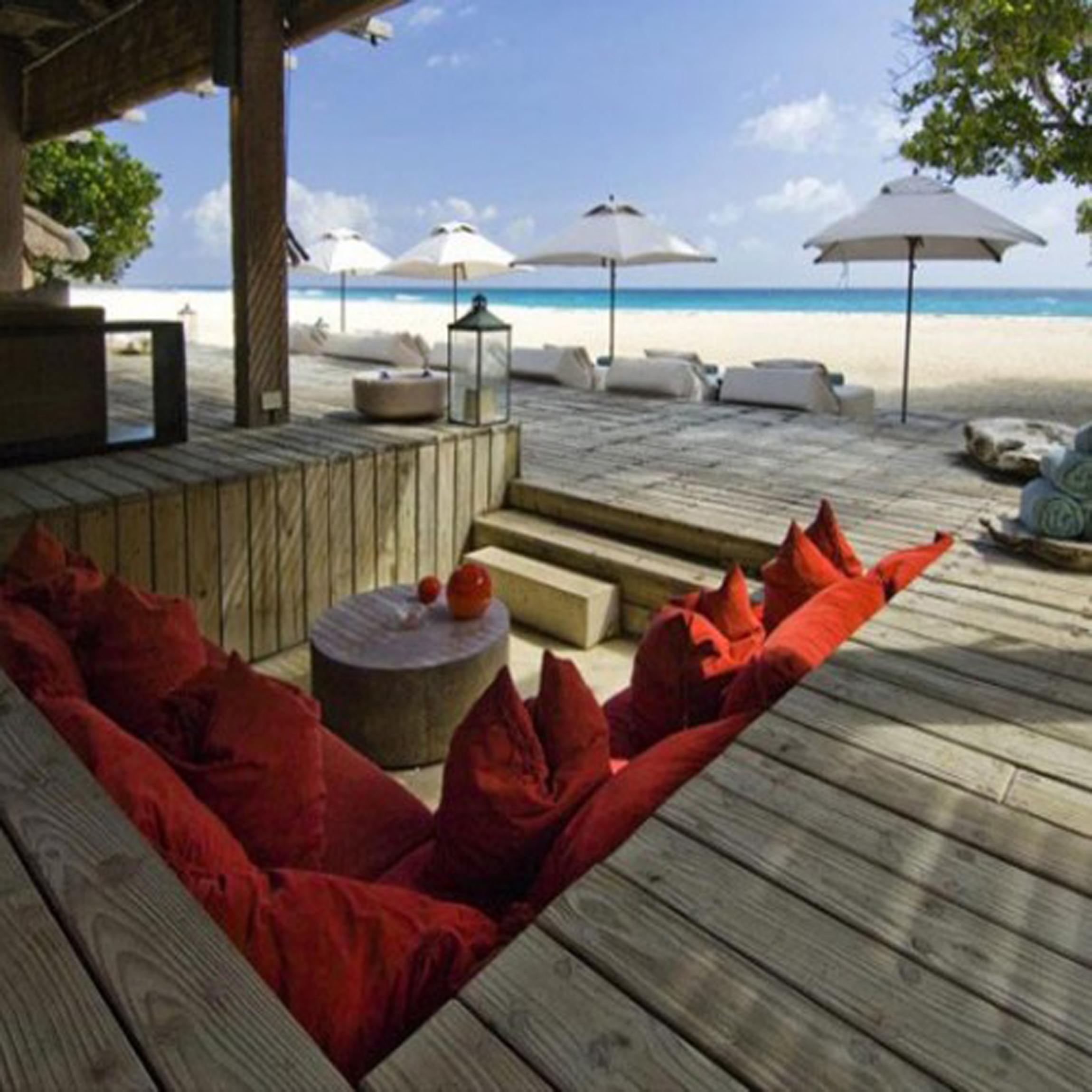 Outdoor Converstation Pit With Sunken Area Plus Equipped By Comfy Red Sifa And Nice Round Table Also Awesome Beach Scenery View (Image 10 of 20)