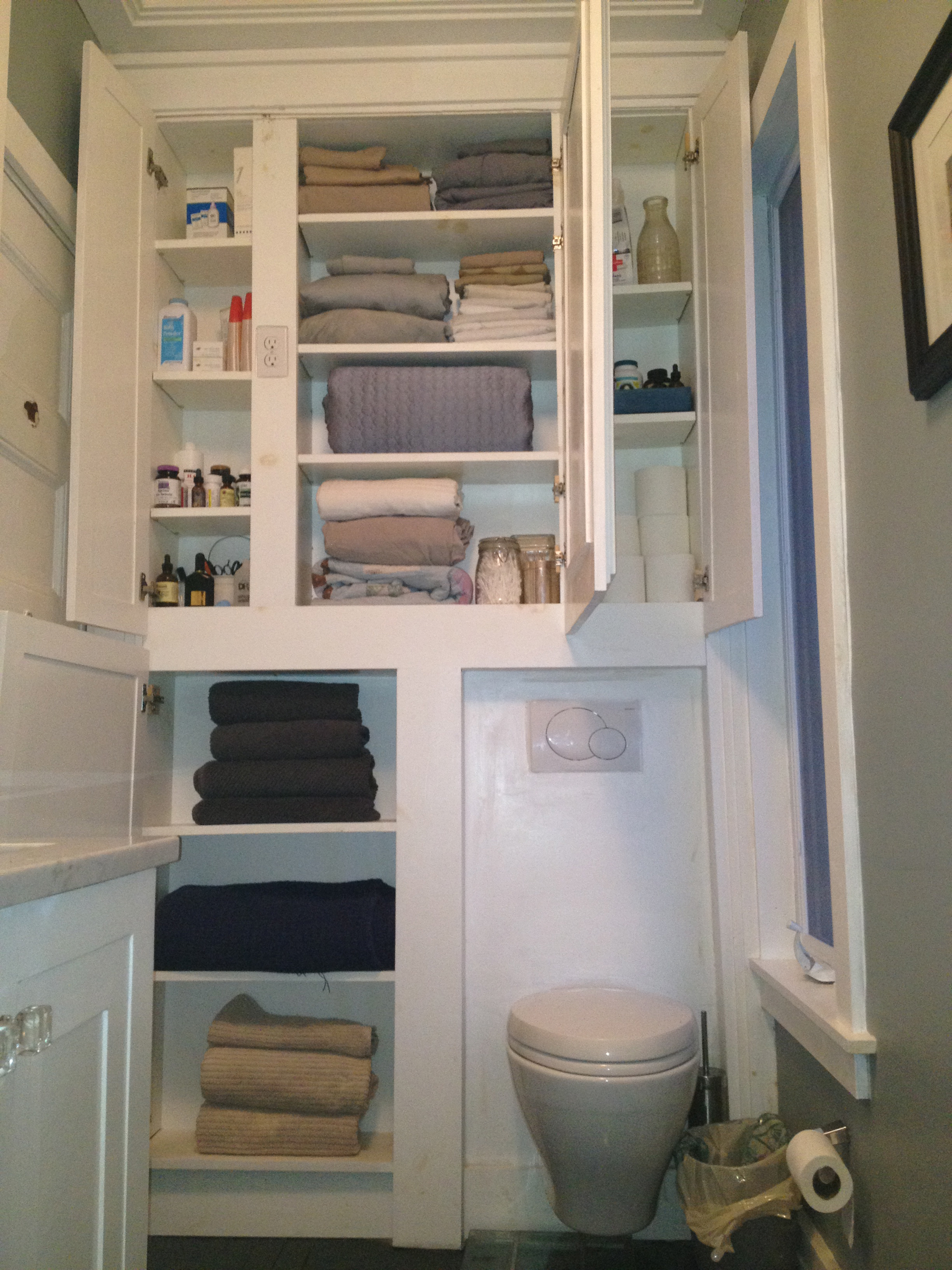 Sweet White Bathroom Wall Cabinet Design Idea With Towels And Bottles Marvelous Bathroom Wall Cabinet Design Ideas (View 10 of 23)