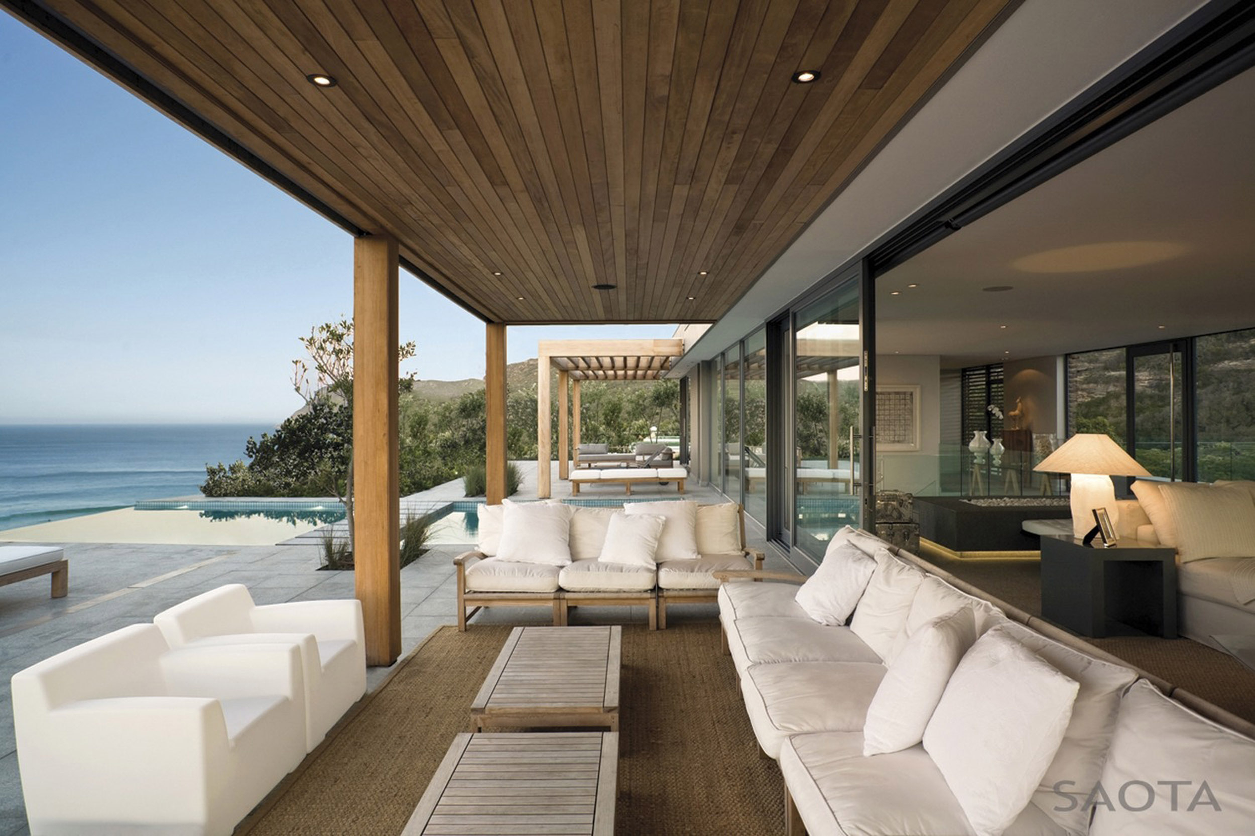 Outdoor Livig Space With White Sofa Set And Wooden Ceiling With Panoramic Ocean View From Plett By Saota Architect Indoor Outdoor Living Spaces (Image 19 of 20)