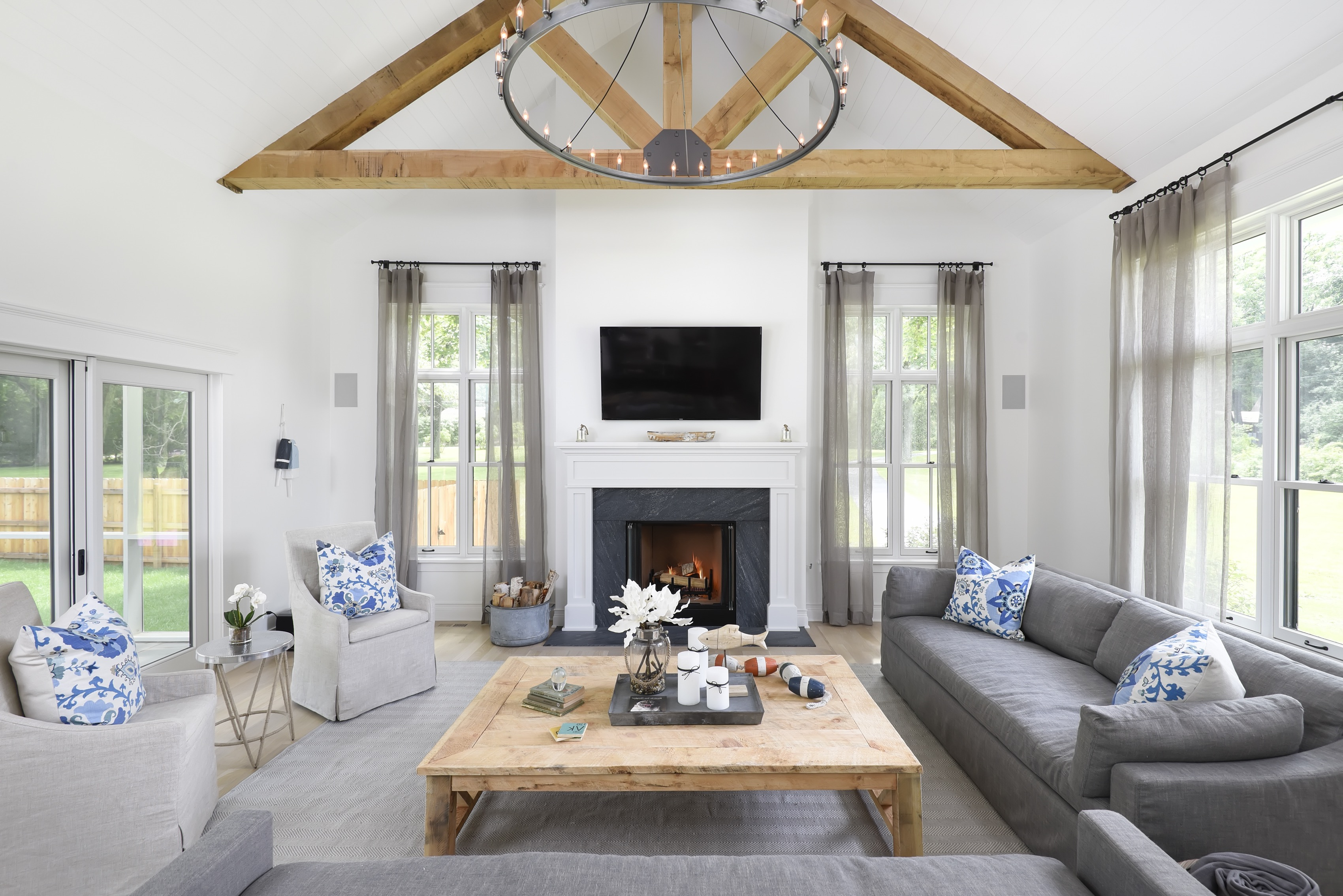 Gray Country Living Room With Exposed Beams (View 15 of 18)