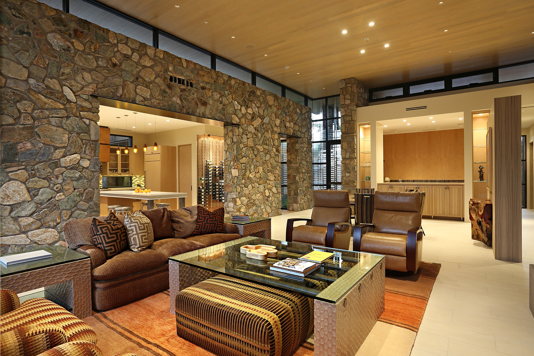 Luxury Southwestern Living Room With Stone Accent Wall (View 16 of 18)