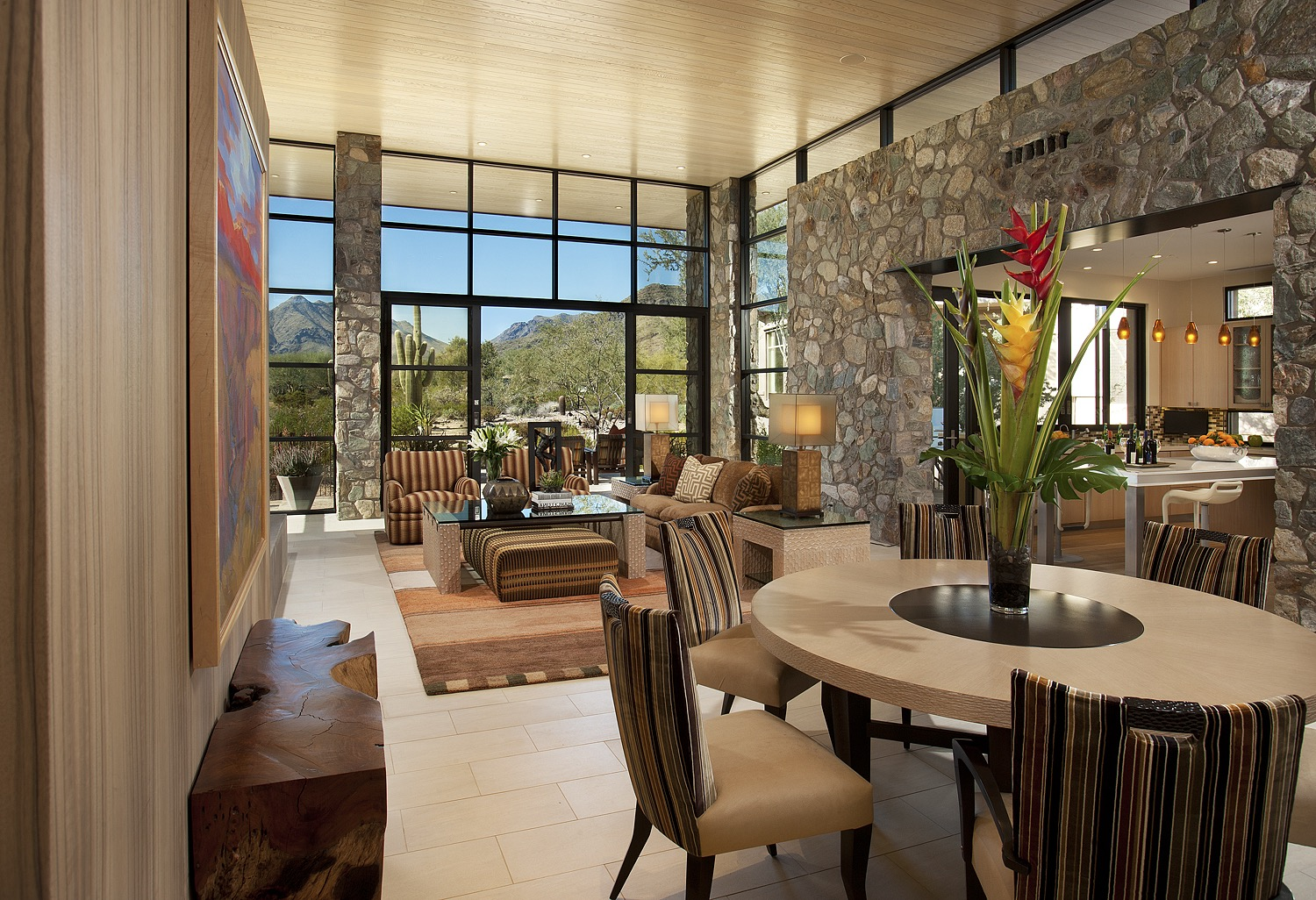 Sunny Southwestern Living Room And Dining Room Combo With Stone Accents (Image 12 of 18)