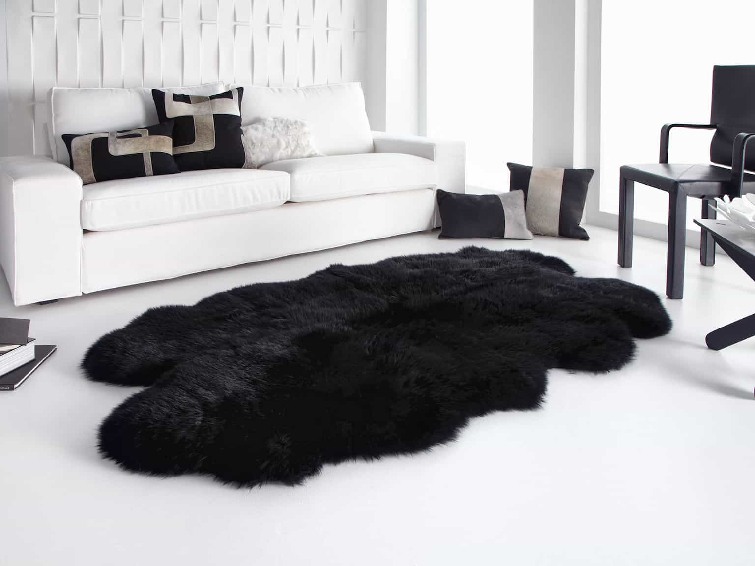 Black And White Minimalist Living Room With Quarto Ivory Longwool Black Sheepskin Rug (View 14 of 15)