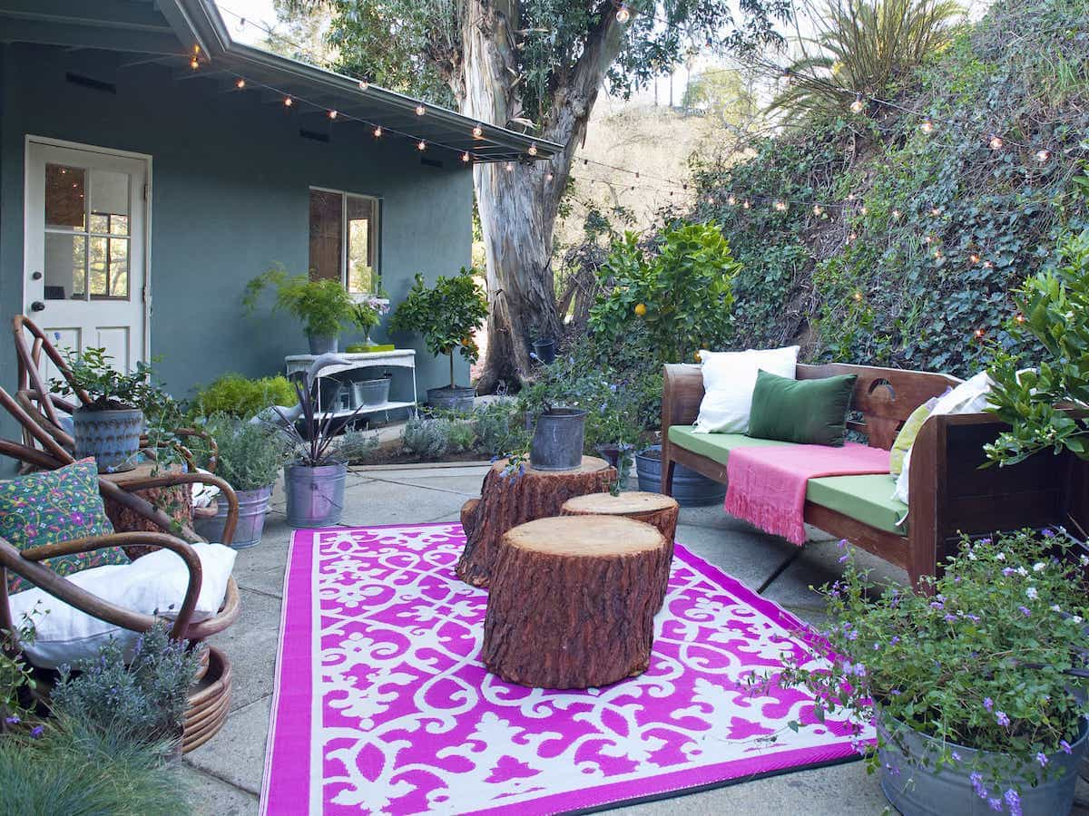 Bohemian Patio With Pink Outdoor Rug Finished Outdoor Living Room (View 13 of 15)