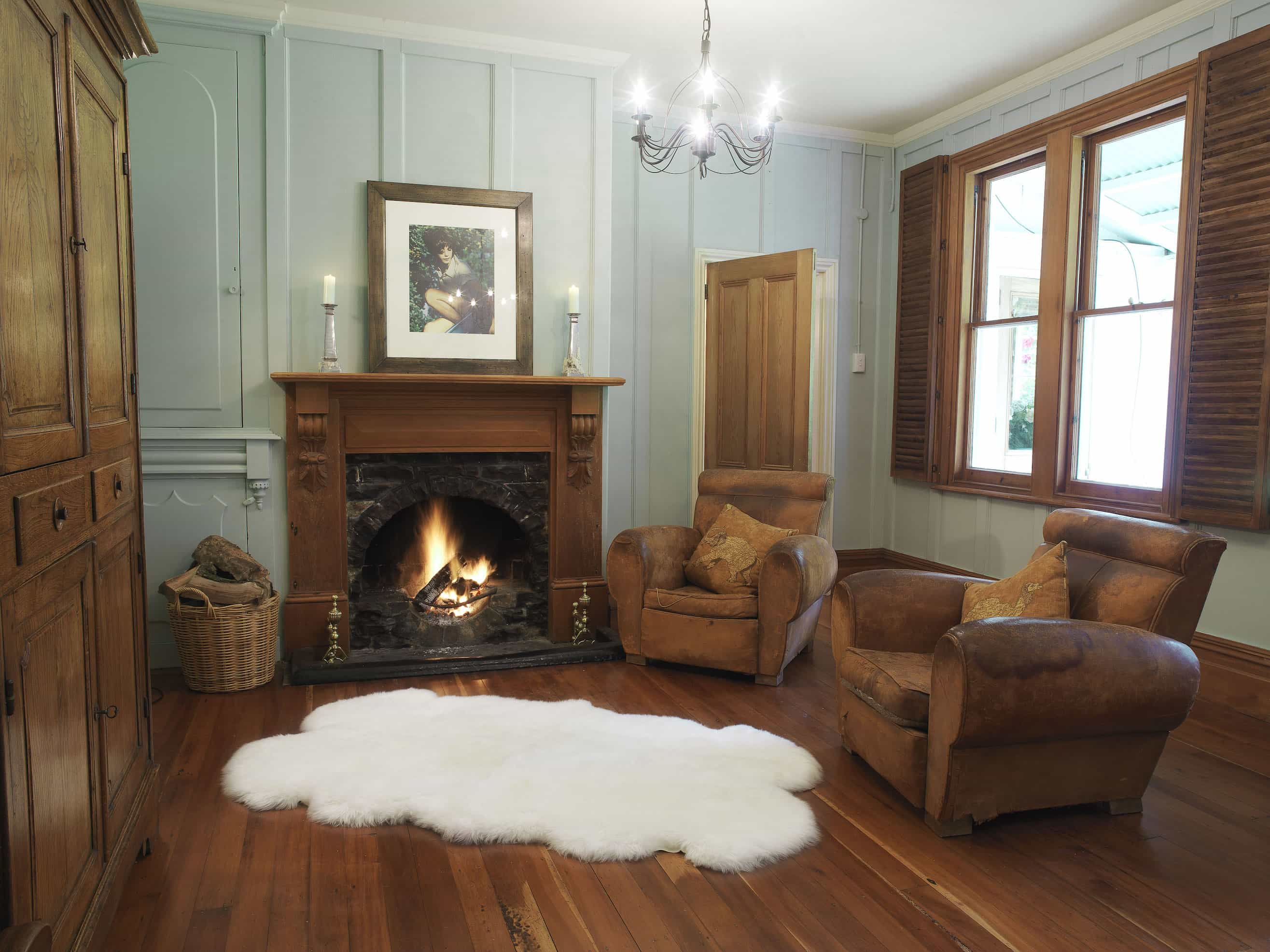 Classic Living Room With Wood Fireplace And Quarto Ivory Longwool Sheepskin Rug (View 7 of 15)