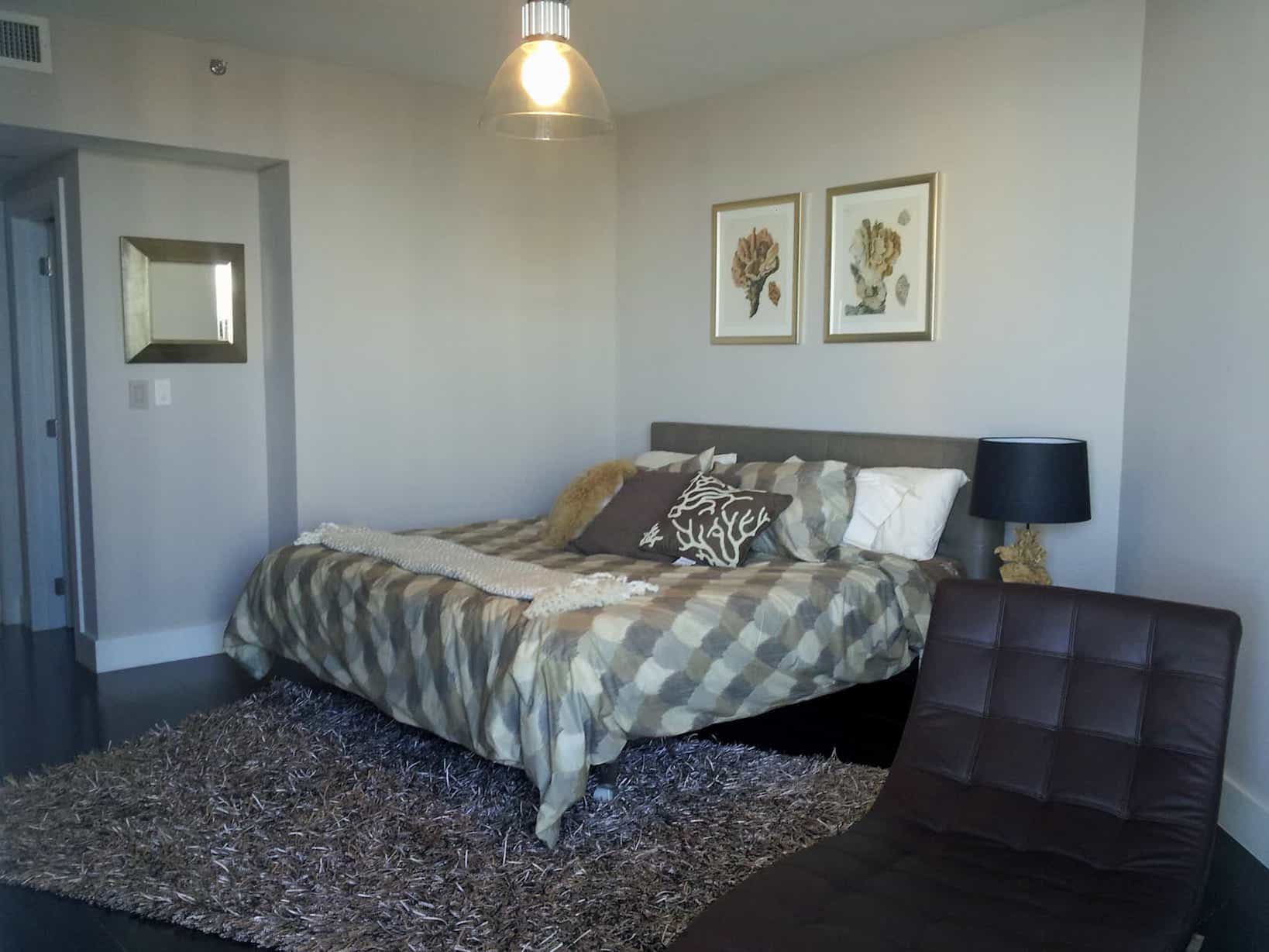 Contemporary Coastal Bedroom With Shag Rug And Chocolate Brown Leather Chaise Is The Perfect Spot For Reading In This Guest Bedroom Retreat (View 8 of 15)