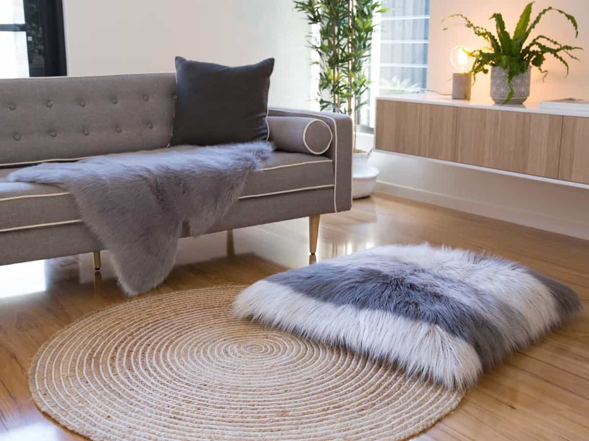 Contemporary Living Room With Mocka Faux Sheepskin Rug Grey With Neve Cushion And Swirl Rug (Image 6 of 15)