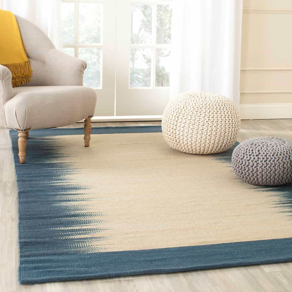 Cozy Sitting Room With Flat Woven Off White Tribal Jute Wool Rug (Image 4 of 15)