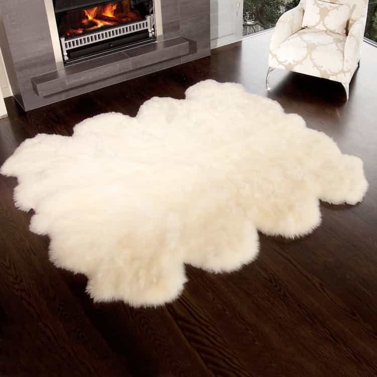 Elegant Sitting Room With Modern Fireplace And Premium Octo Sheepskin Rugs (Image 10 of 15)