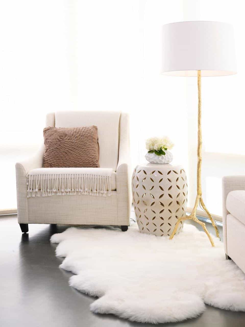 Fancy Sitting Room With White Chair And White Faux Sheepskin Rug (Image 11 of 15)