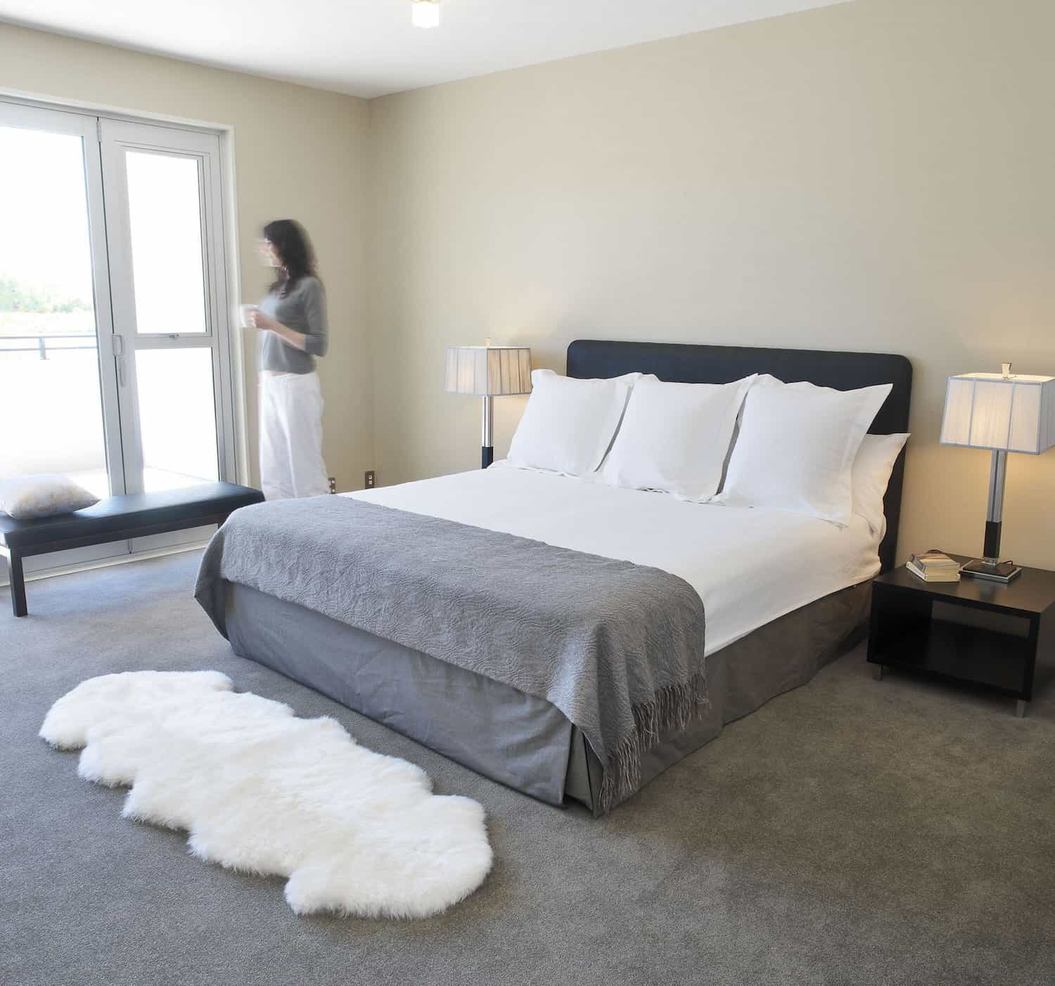 Minimalist Bedroom Decor With Double Pelt Sheepskin Rug (View 4 of 15)