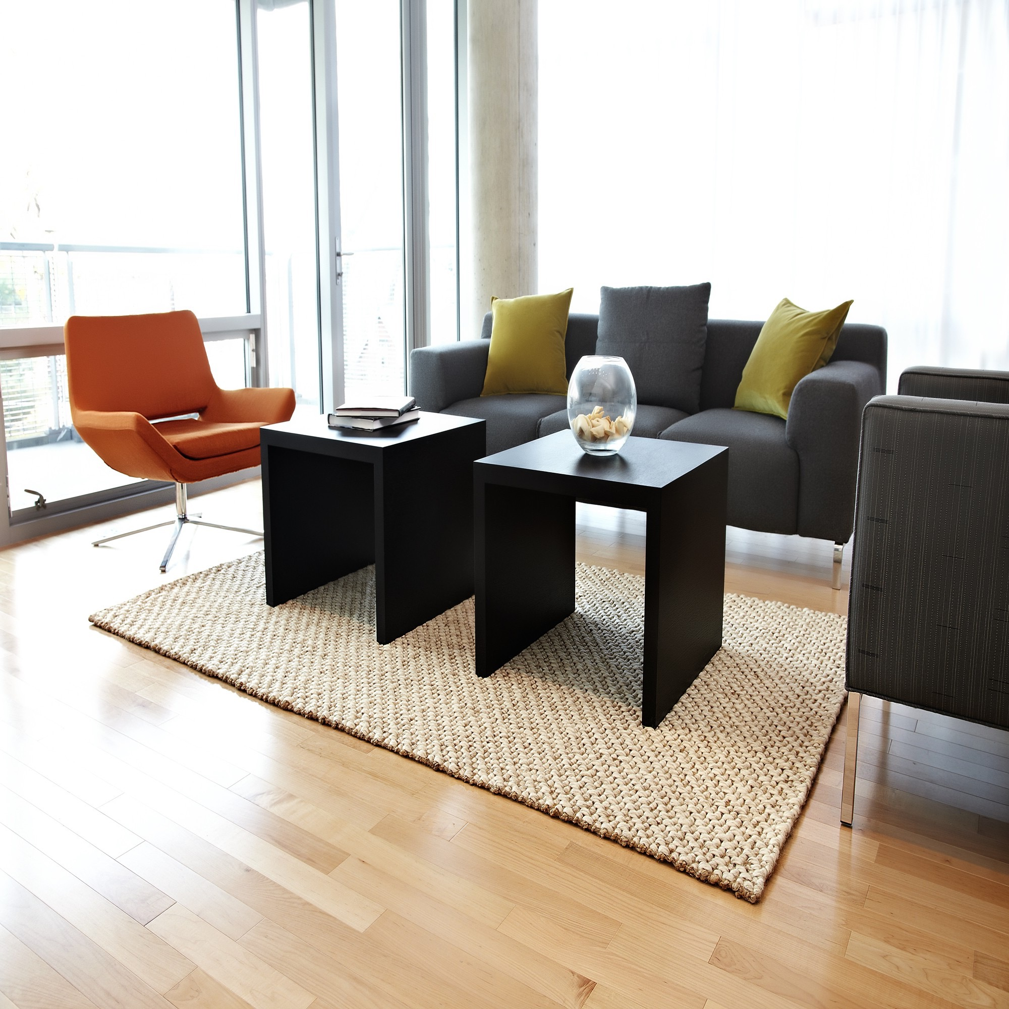 Modern Minimalist Apartment Living Room With Flat Chairs And Jute Braided Rug (Image 8 of 15)