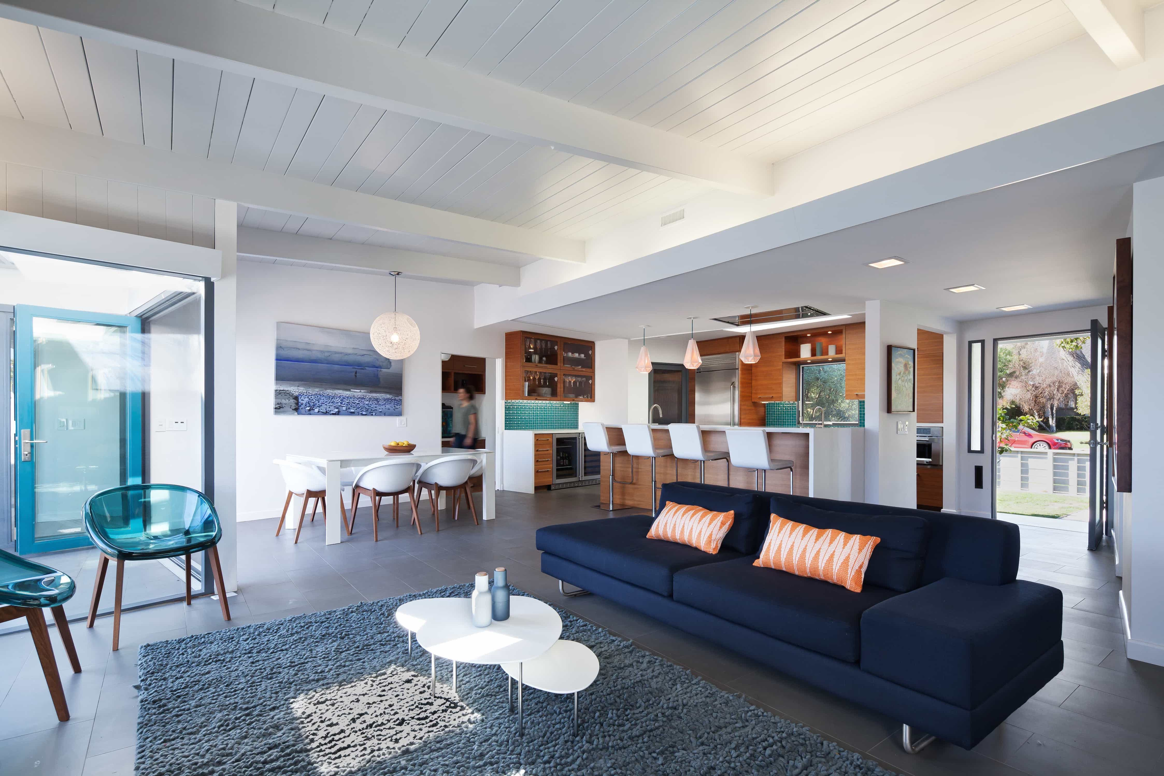 Navy Blue Shag Rug and Sofa in Open Floor Plan Modern Living Room With Exposed Ceiling Beams and Blue Accents