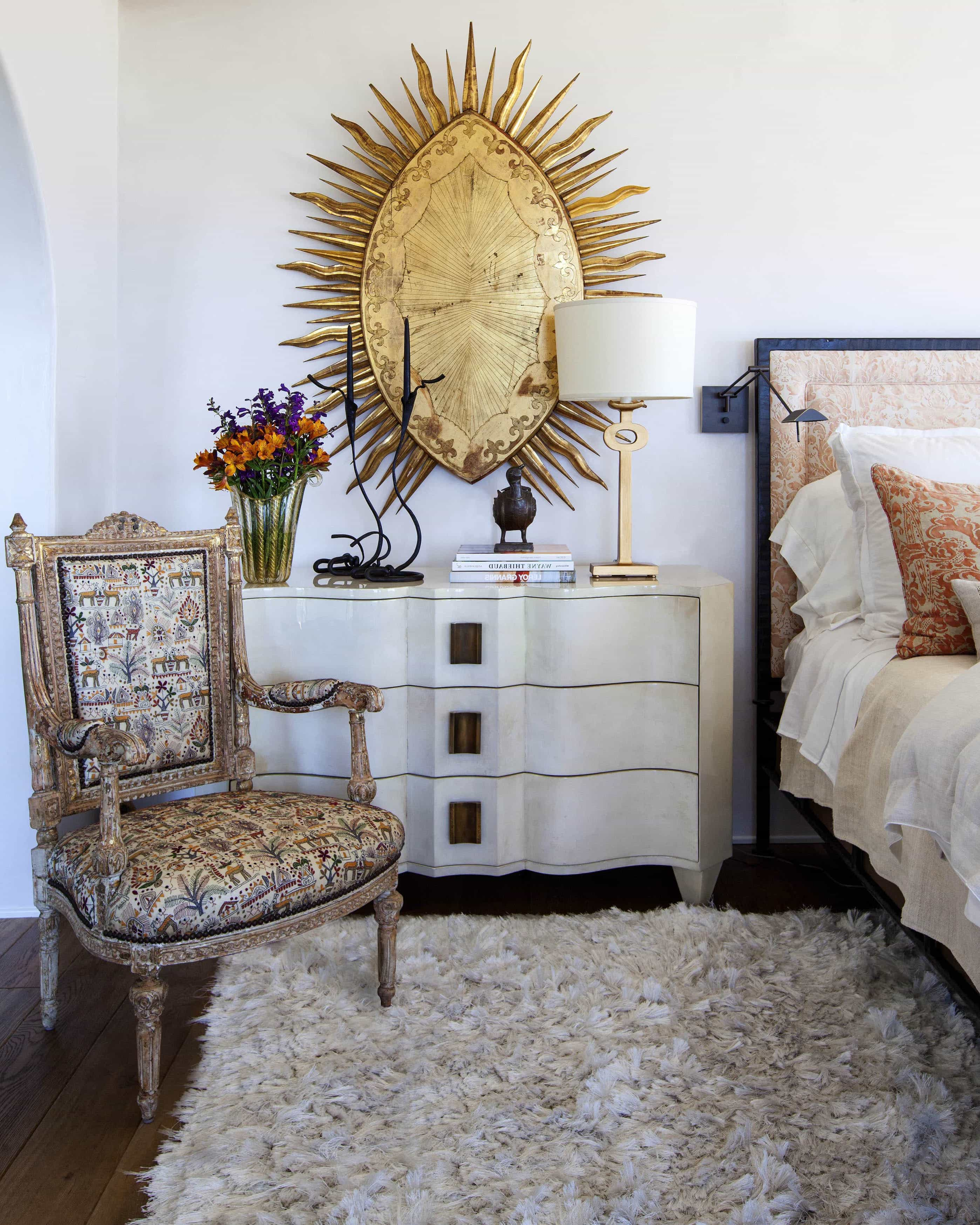 White Bedside Table With Large Metal Hanging Art With Flokati Rug And Upholstered Chair (Image 10 of 10)