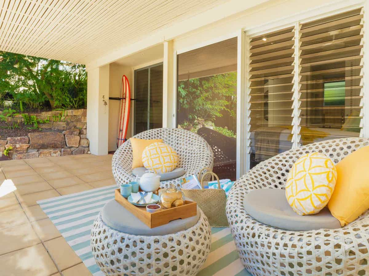 apartment-decks-outdoor-rug for Small Patio With Seafoam Blue Striped Rug Under Woven Bubble Furniture With Yellow Throw Pillows