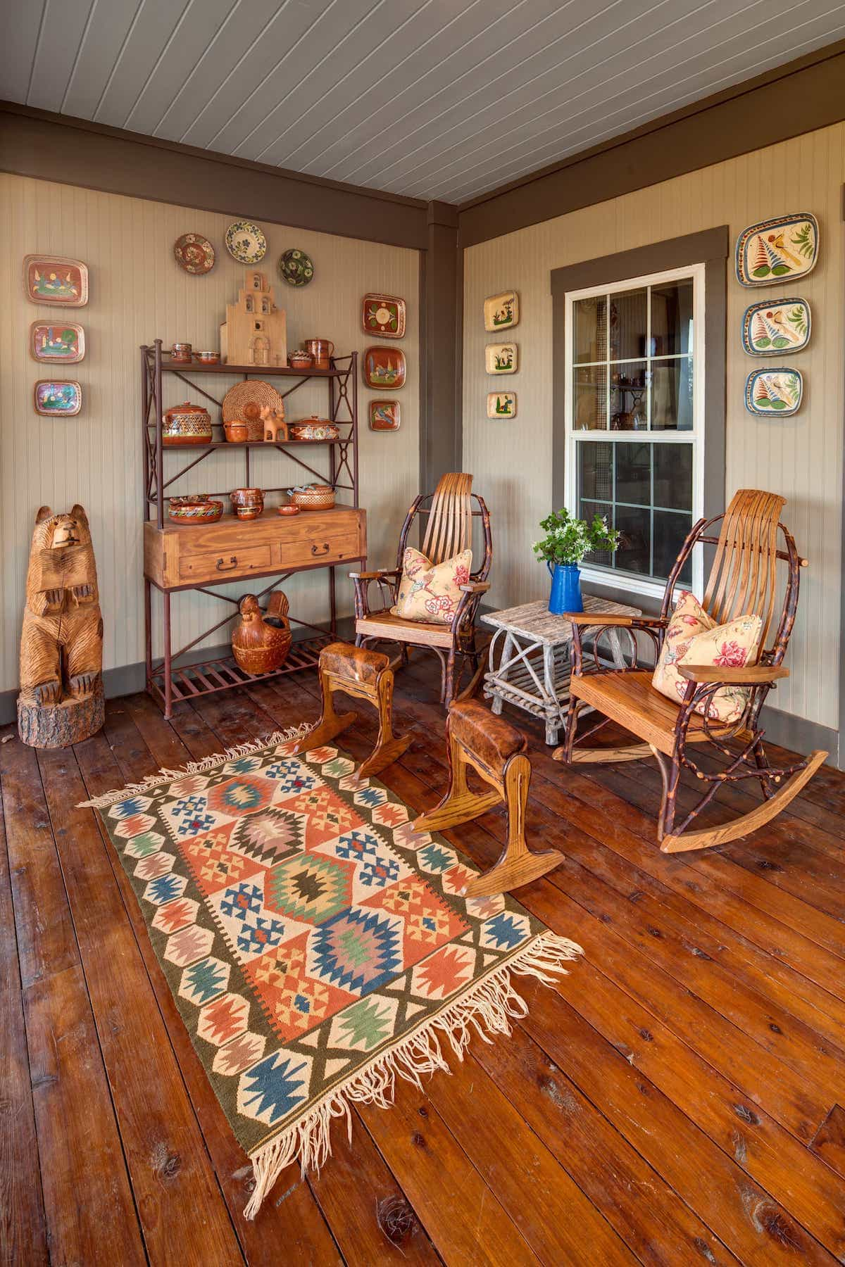 Bold Tribal Print Southwestern Rug For Wooden Rocking Chairs Create Cozy Porch Seating Area (Image 2 of 15)