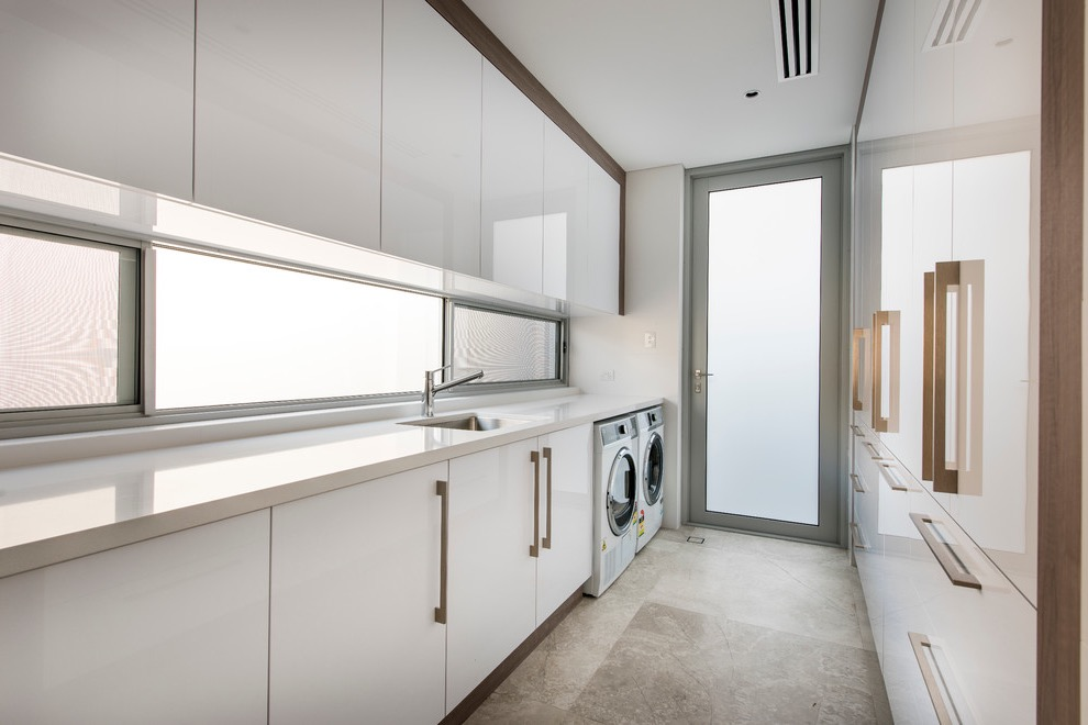 Contemporary Laundry Room With Flat Panel Cabinet Storage (View 4 of 20)