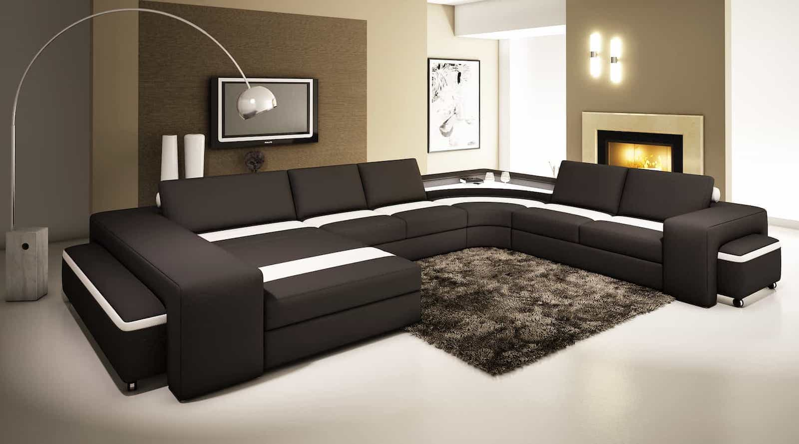 Modern Living Room Design With Elegant Black U Shaped Couch And Flokati Rugs (Image 9 of 10)
