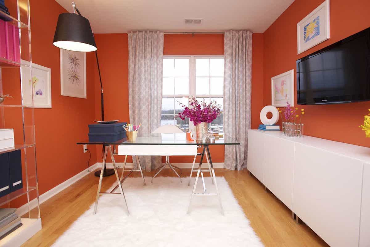 Modern Orange Home Office With Glass Desk And White Faux Fur Area Rug (View 5 of 8)