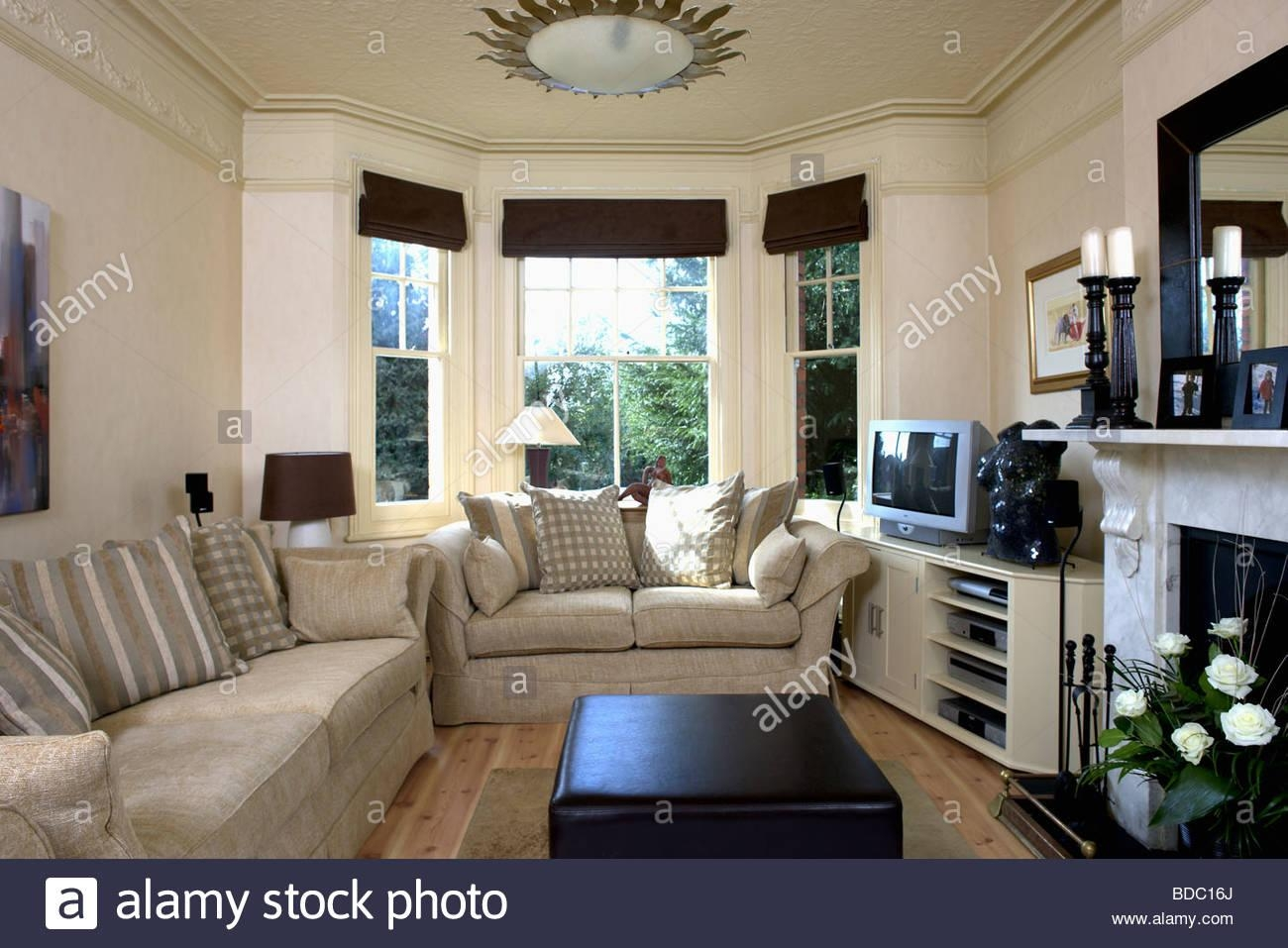 Beige Sofas In Cream Living Room With Black Blinds On Bay Window In Bay Window Sofas (View 10 of 20)