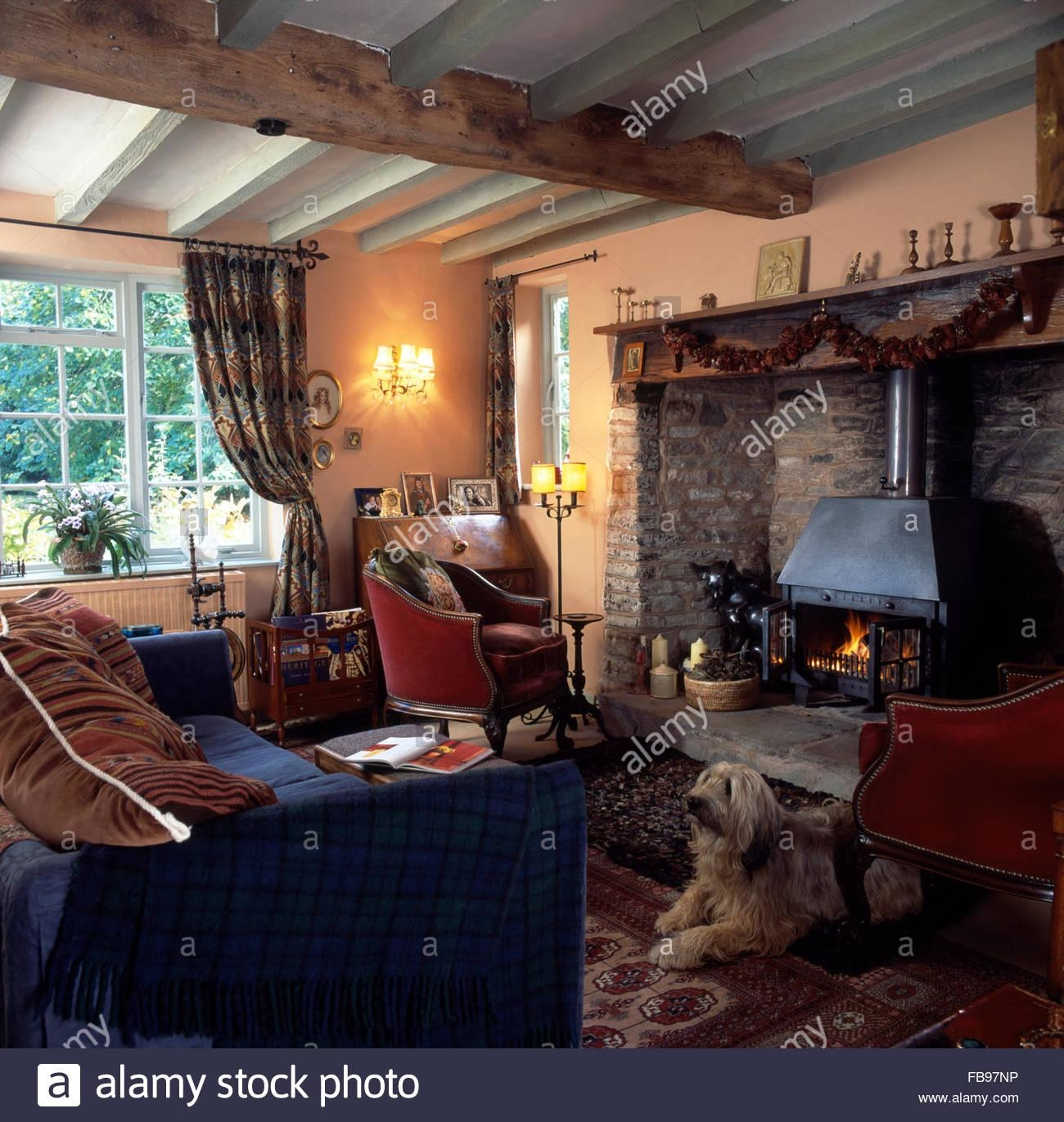 Blue Sofa And Red Chairs In Country Sitting Room With A Wood Pertaining To Country Sofas And Chairs (View 20 of 20)